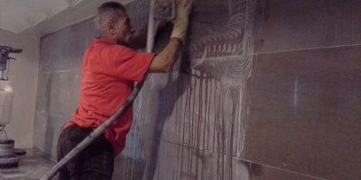 levigatura restauro piano verticale parete